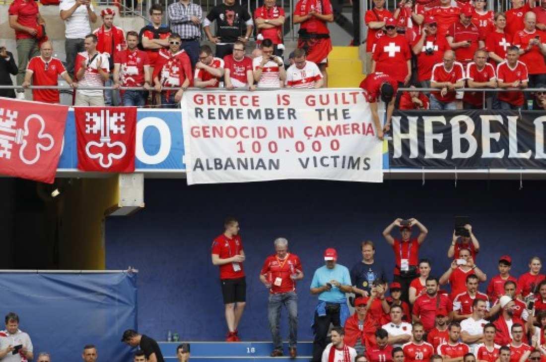Σε μια ακόμη προκλητική κίνηση προέβησαν οι Αλβανοί κατά της χώρας μας, αφού λίγο πριν τη σέντρα του αγώνα τους αντιπροσωπευτικού τους συγκροτήματος με την Ελβετία, σήκωσαν ένα προκλητικό πανό, γραμμένος στην αγγλική γλώσσα. Ειδικότερα, το πανό  έγραφε «Η Ελλάδα είναι ένοχη. Θυμηθείτε τη γενοκτονία της Τσαμουριάς. 100.000 Αλβανοί θύματα». Η συγκεκριμένη κίνηση είναι αντίθετη με τις οδηγίες της UEFA, η οποία έχει ξεκαθαρίσει ότι δεν θέλει πολιτικά μηνύματα, μέσα στα γήπεδα.  Λίγο μετά την έναρξη της αναμέτρη